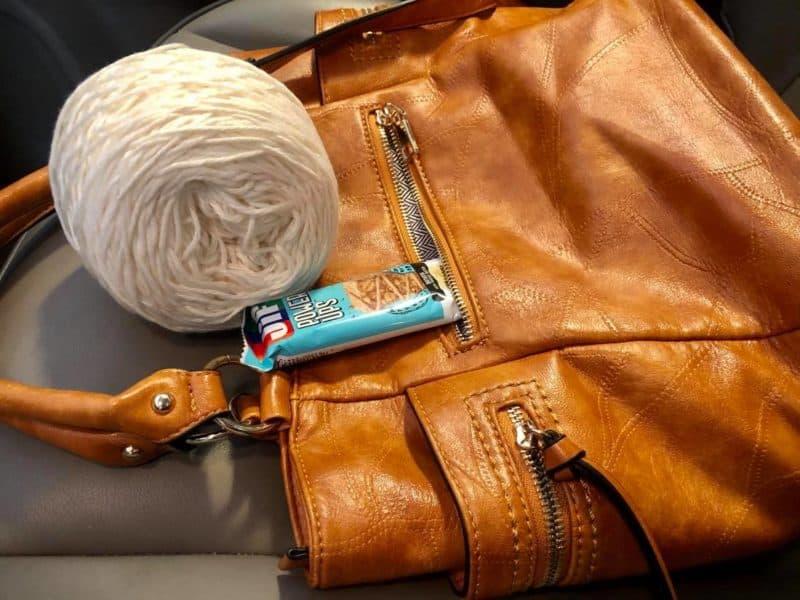purse with yarn in car