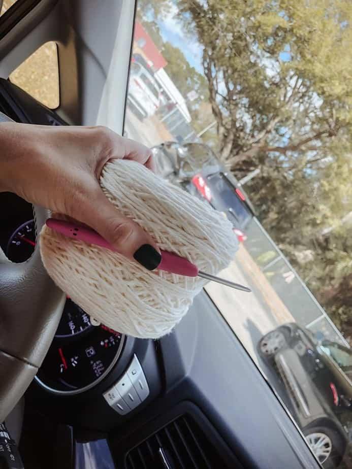 me holding yarn in car