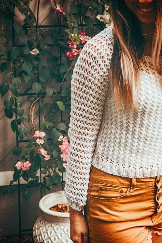 Girl in a hand knit white summer sweater
