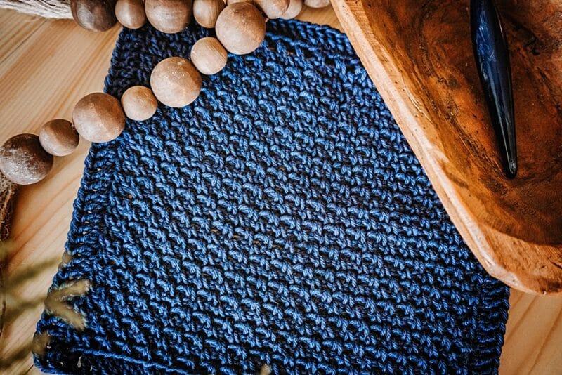 a textured blue crochet fabric